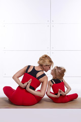 Mother daughter doing yoga exercise, fitness, gym sports pai