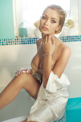 Beautiful blonde woman posing in bathroom