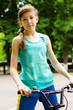 Athletic young teenage girl with a bicycle