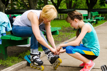 Woman getting help putting on rollerblades