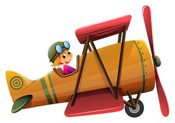 A smiling pilot on a vintage plane