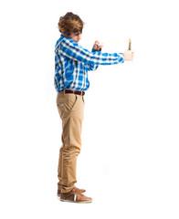 teenager holding a slingshot