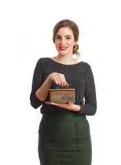 Young girl holding a strongbox