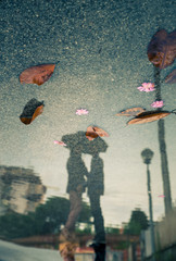 couple kissing, water reflection view