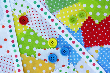 Accessories for needlework: fabric, band, buttons of yellow, gre