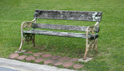 wooden park bench at park