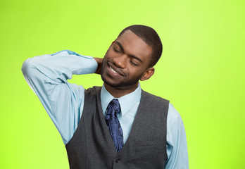 Portrait young man with neck, back pain, green background