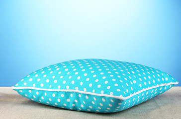 Blue bright pillow on blue background