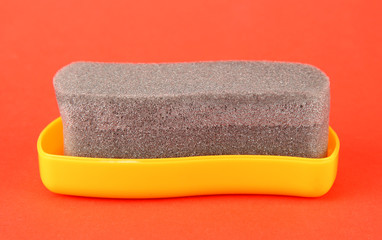 Shoe shine sponge, on color background