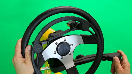 Steering wheel for disabled isolated on green