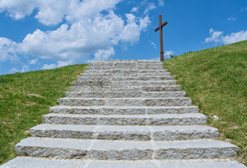 Cross and stone stairs