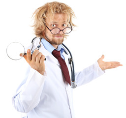 Funny doctor in glasses holding magnifier isolated on white