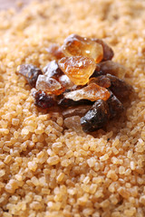 Reed sugar on brown crystal sugar background