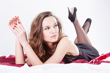 Woman lying on satin bedding