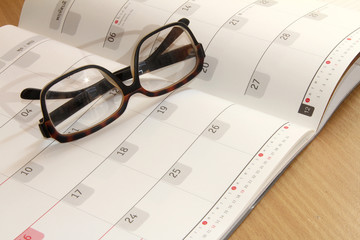 eyeglass on a diary