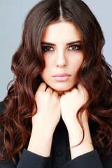 Portrait of a beautiful woman with long brown hair