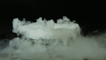 Dry ice in a big glass bowl.