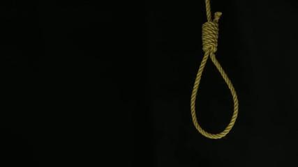 Hand pushing a noose.