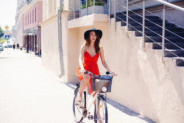 Beautiful woman in dress with bike