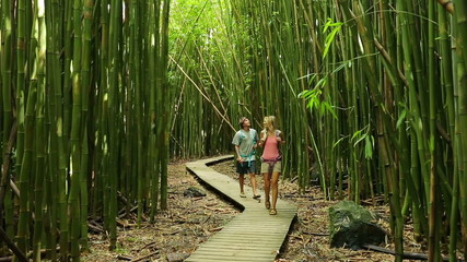 Couple hiking through bamboo forest