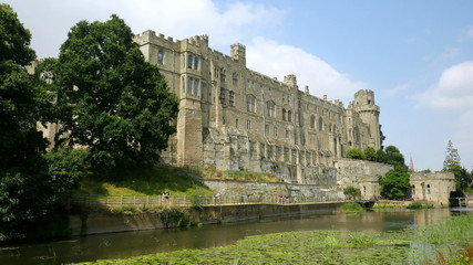 Warwick castle's south facade seen across the River Avon.