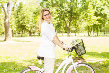 Happy Woman with the Bike