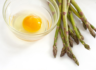 young green asparagus and raw egg