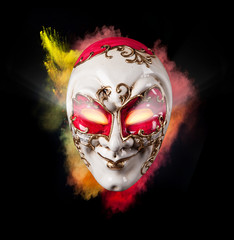 Venice mask with colored powder and glowing eyes