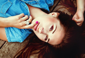 Beautiful girl lying on a wooden floor