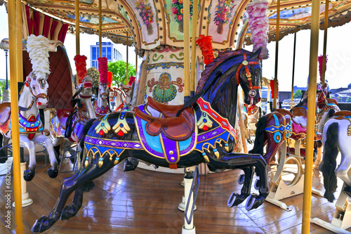 Staande foto Imagination Retro merry-go-round with brightly decorated ponies.