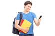Happy male student looking at his cell phone
