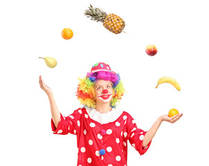 Female clown joggling a bunch of fruits