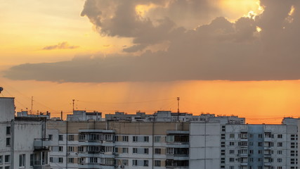 Timelapse of sky with clouds during sunset in city