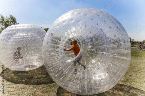 children have fun in the Zorbing Ball - 68201670