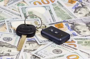 Car keys over dollar