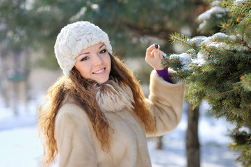 beautiful girl in winter hat walks