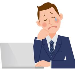 パソコンをするビジネスマン 泣く