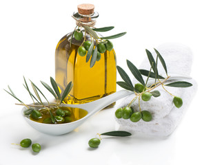 Spa set with olive oil an twig