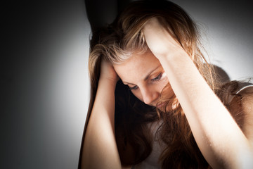 Young woman suffering from a severe depression, anxiety