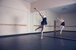 Beautiful ballerina dancing in front of mirror - 68202848