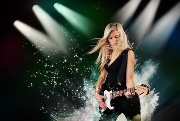 Beautiful blond girl playing on guitar