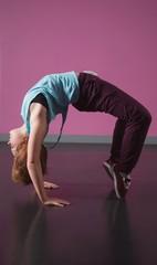Pretty break dancer doing a back bend