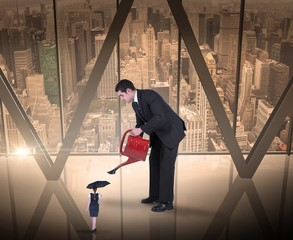 Composite image of businessman watering tiny business woman