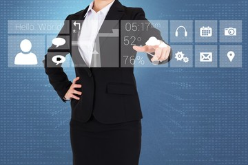 Businesswoman in suit pointing finger to app menu