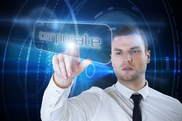 Businessman pointing to word corporate