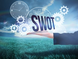 Businesswomans hand presenting the word swot