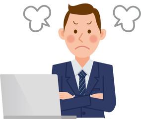 パソコンをするビジネスマン 怒る
