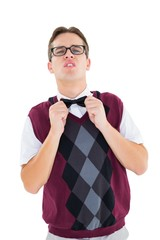 Geeky hipster fixing his bow tie