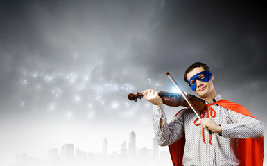 Superman playing violin