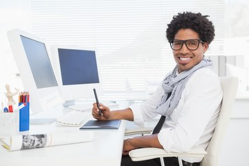 Hipster businessman working at his desk